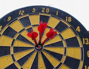 1800-dartboard-with-three-darts-in-bullseye-pv